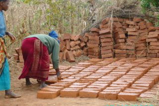Bricks are being laid out to dry after moulding